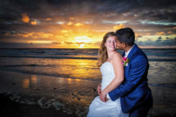 wedding couple at sunset by sea