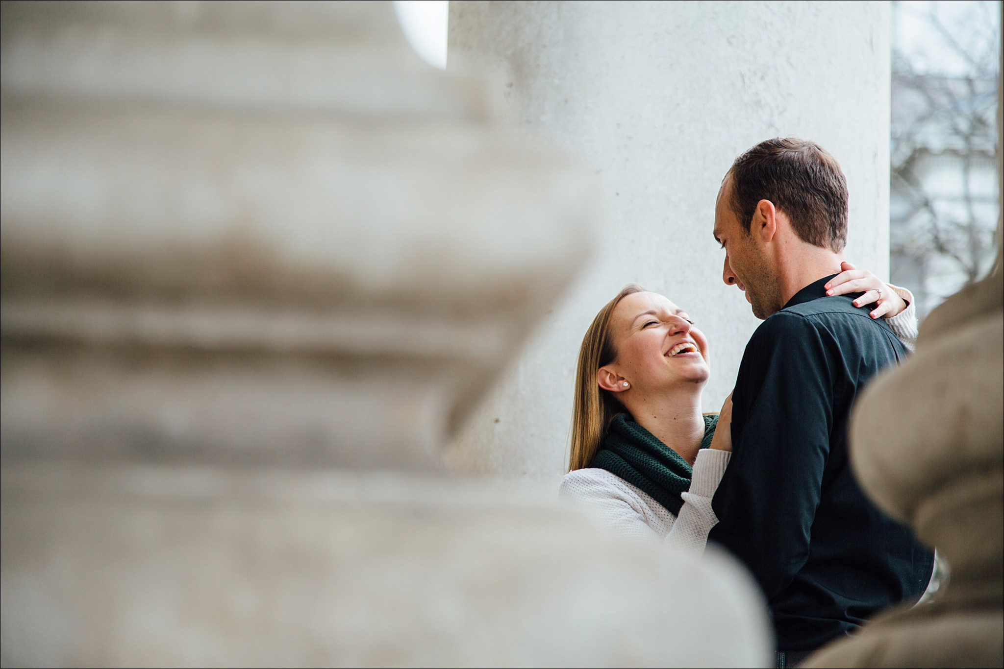 engaged couple embracing during their engagement shoot in Dublin city
