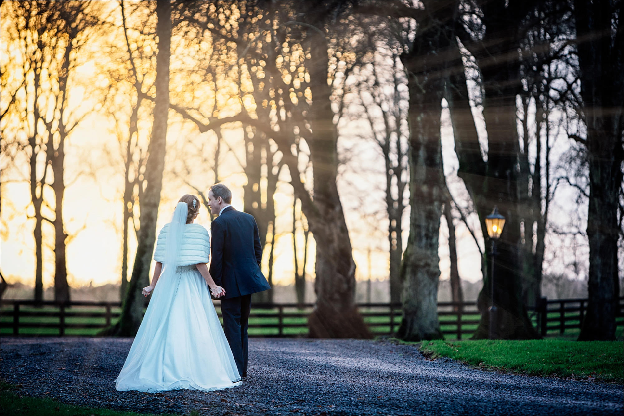 Bride and groom kissing at sunset outside Tankardstown House