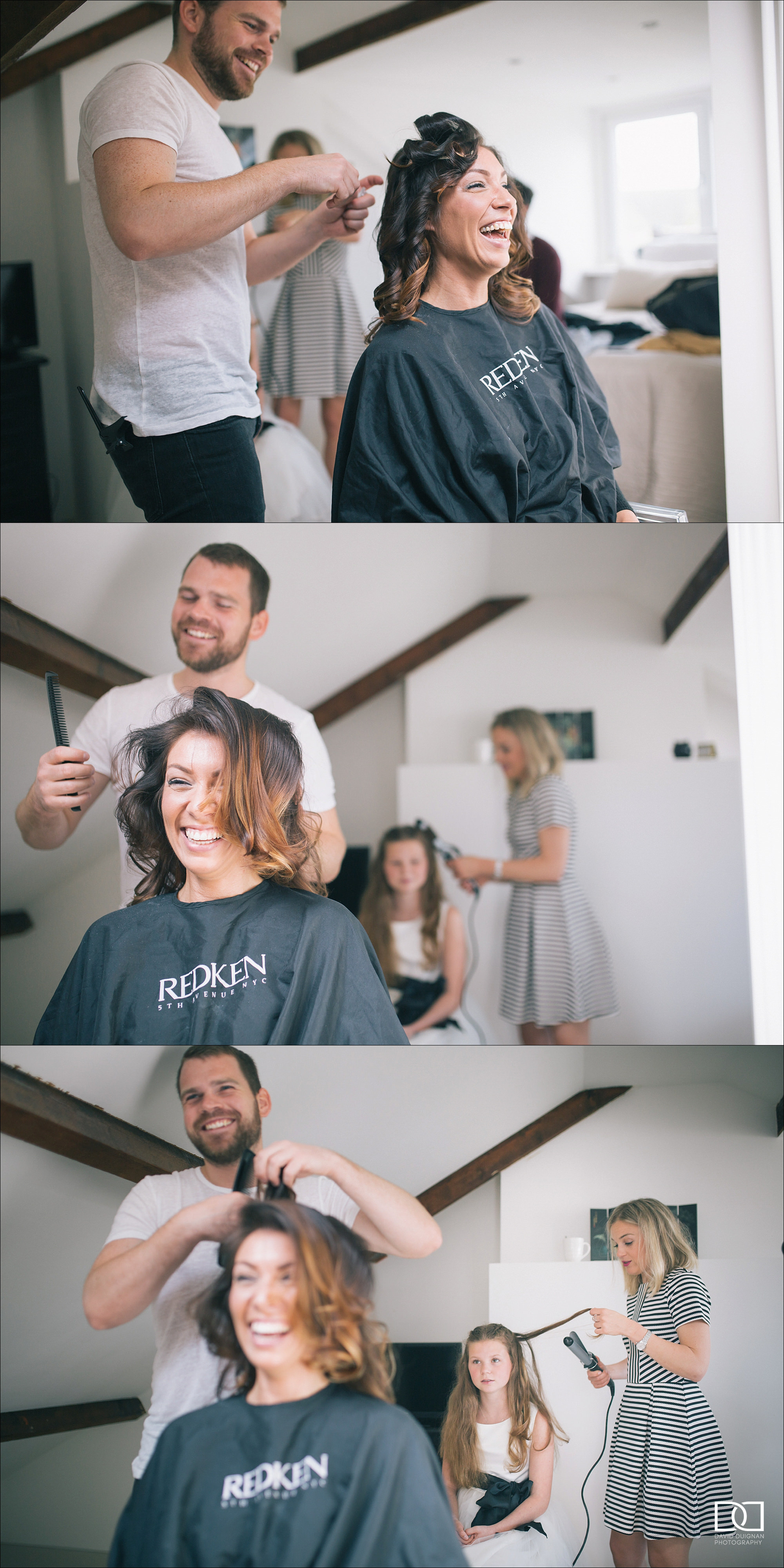 bride laughing getting her makeup applied