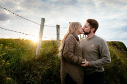 engaged couple at sunset in west of ireland