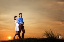 engaged couple at sunset photographed by david duignan photography