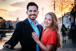 engaged couple on the liffey boardwalk dublin