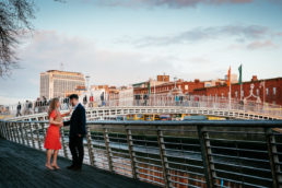 engaged couple on the liffey boardwalk dublin