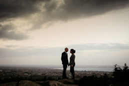 engaged couple looking out over dublin