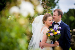 Bride and groom embracing at their bellingham castle wedding