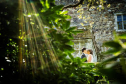 bride and groom kissing at waterford castle