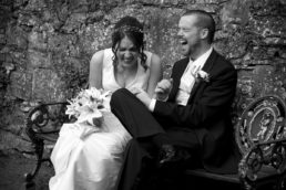 Bride and groom laughing hysterically