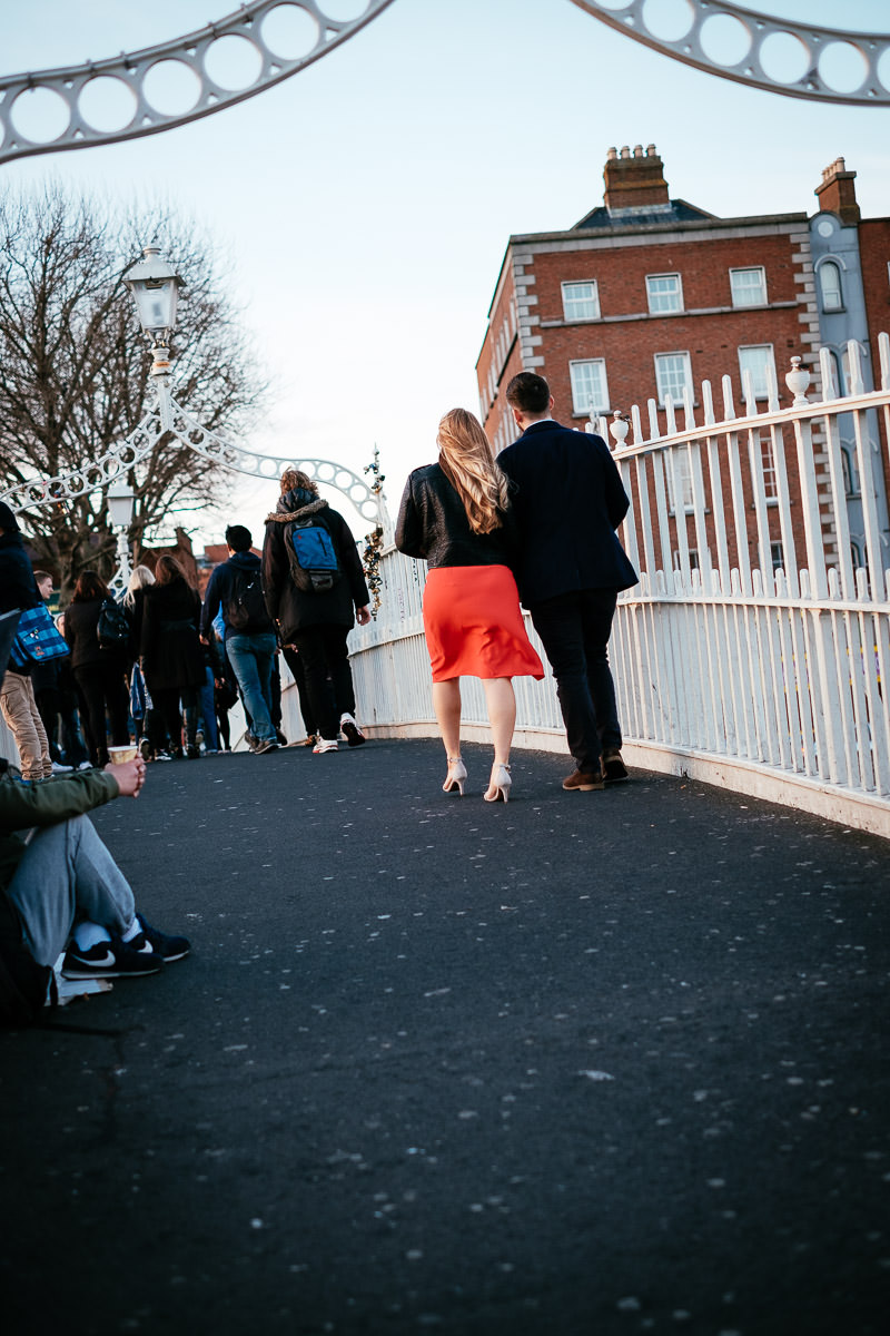 engaged couple on the ha'penny bridge dublin