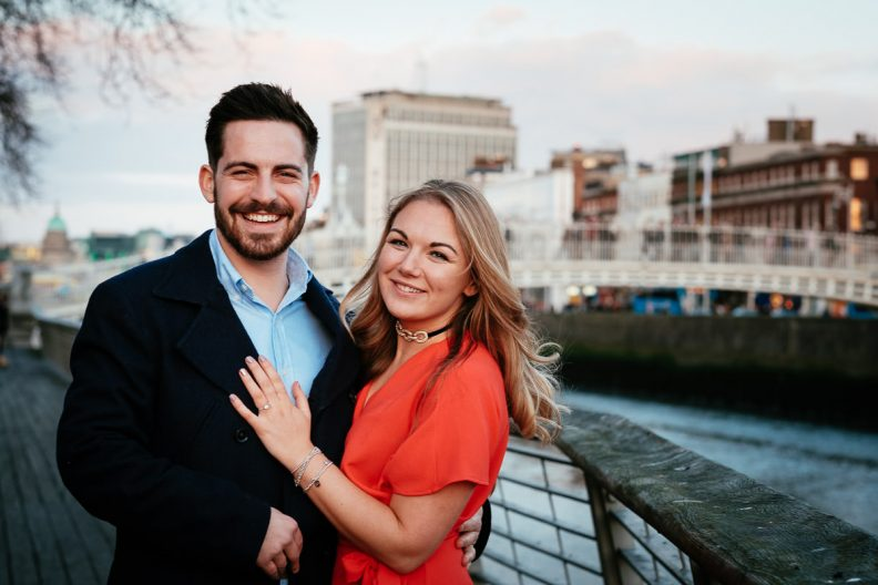engaged couple on the river liffey boardwalk dublin