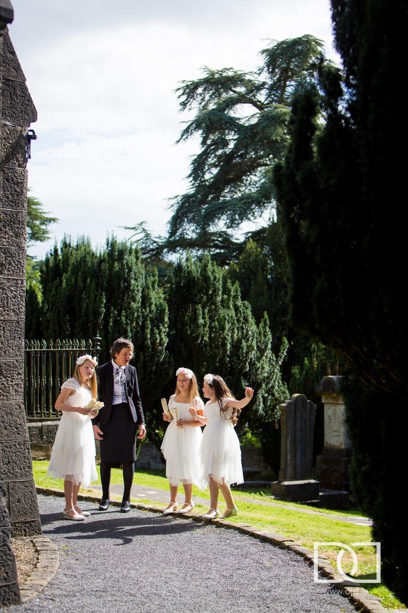 flower girls outside church at castle leslie
