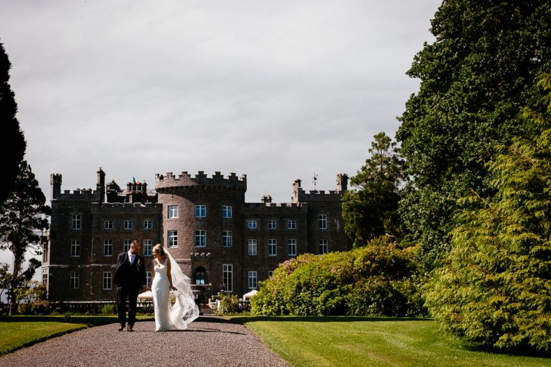 bride and groom walking through the gardens at their markree castle wedding