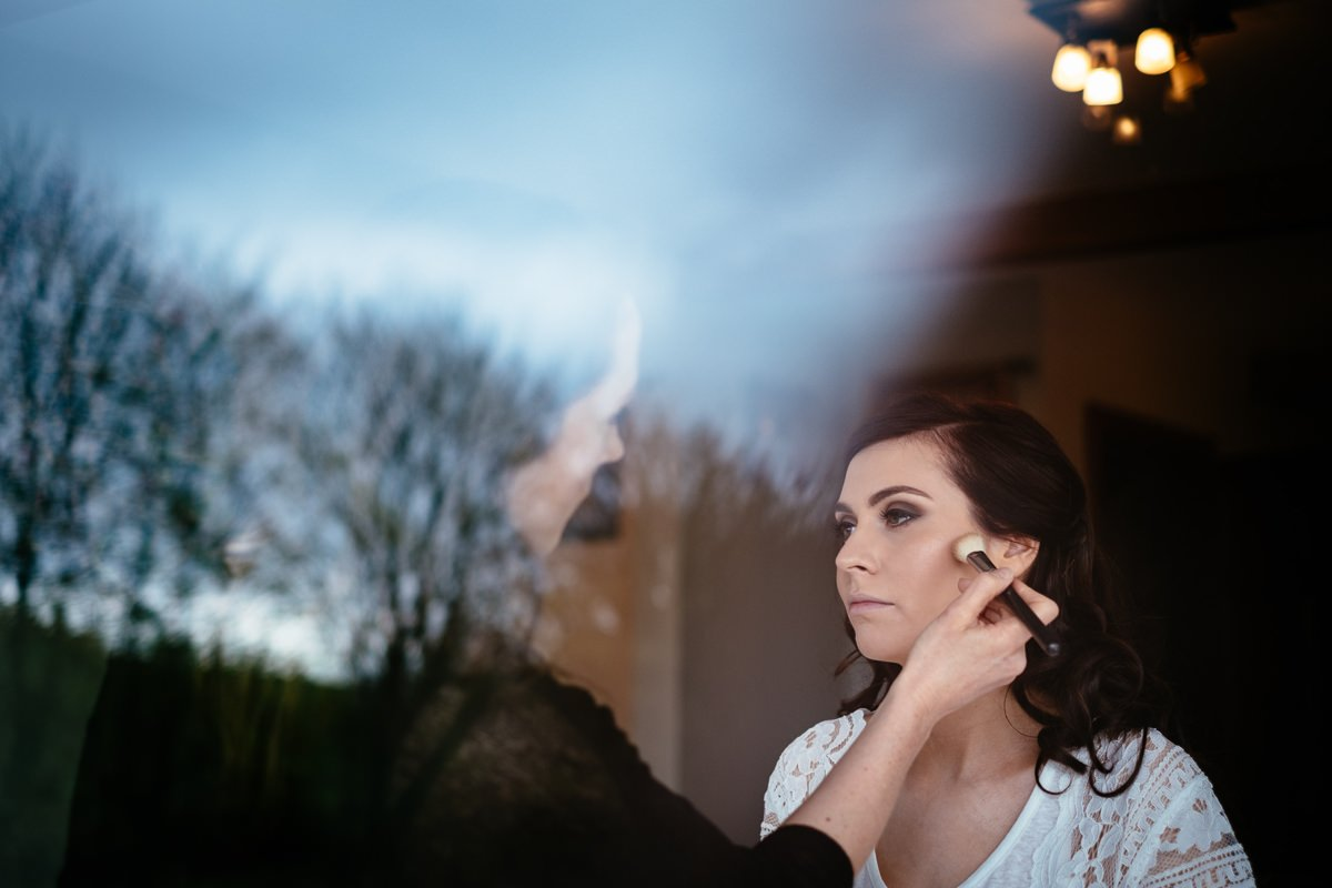 bride getting makeup applied