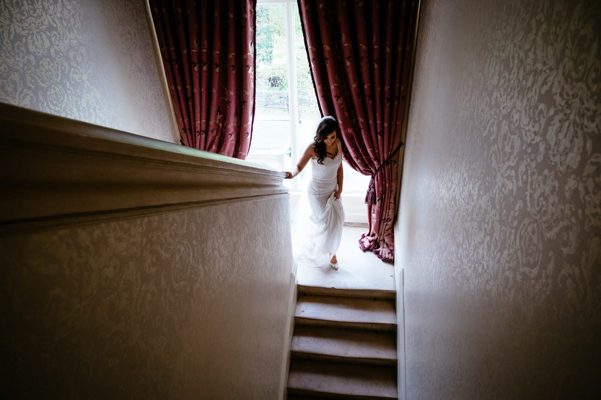 bride walking down stairs to her an outdoor wedding at Tankardstown House Slane