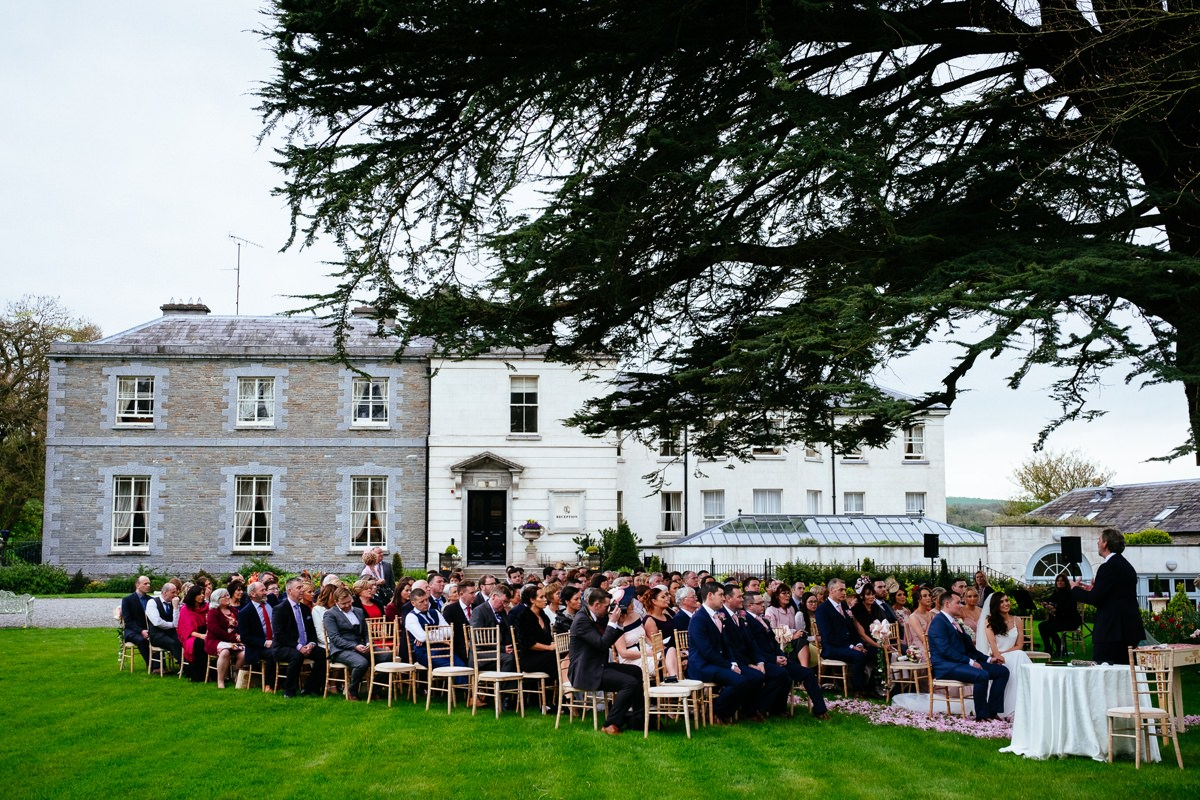 guests sitting for an outdoor wedding at Tankardstown House Slane