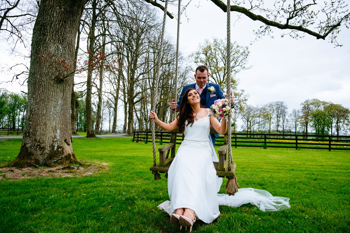bride and groom on the swing at Tankardstown House Slane