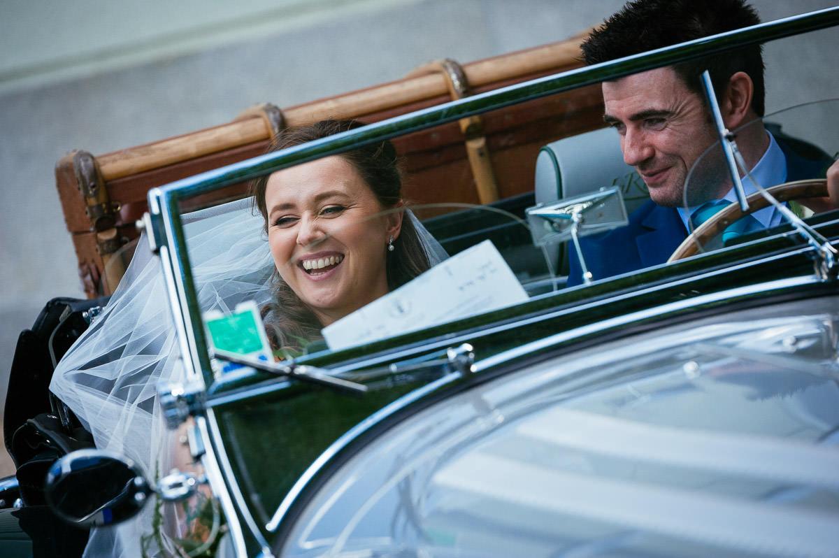 bride and groom in vintage car at a k club wedding