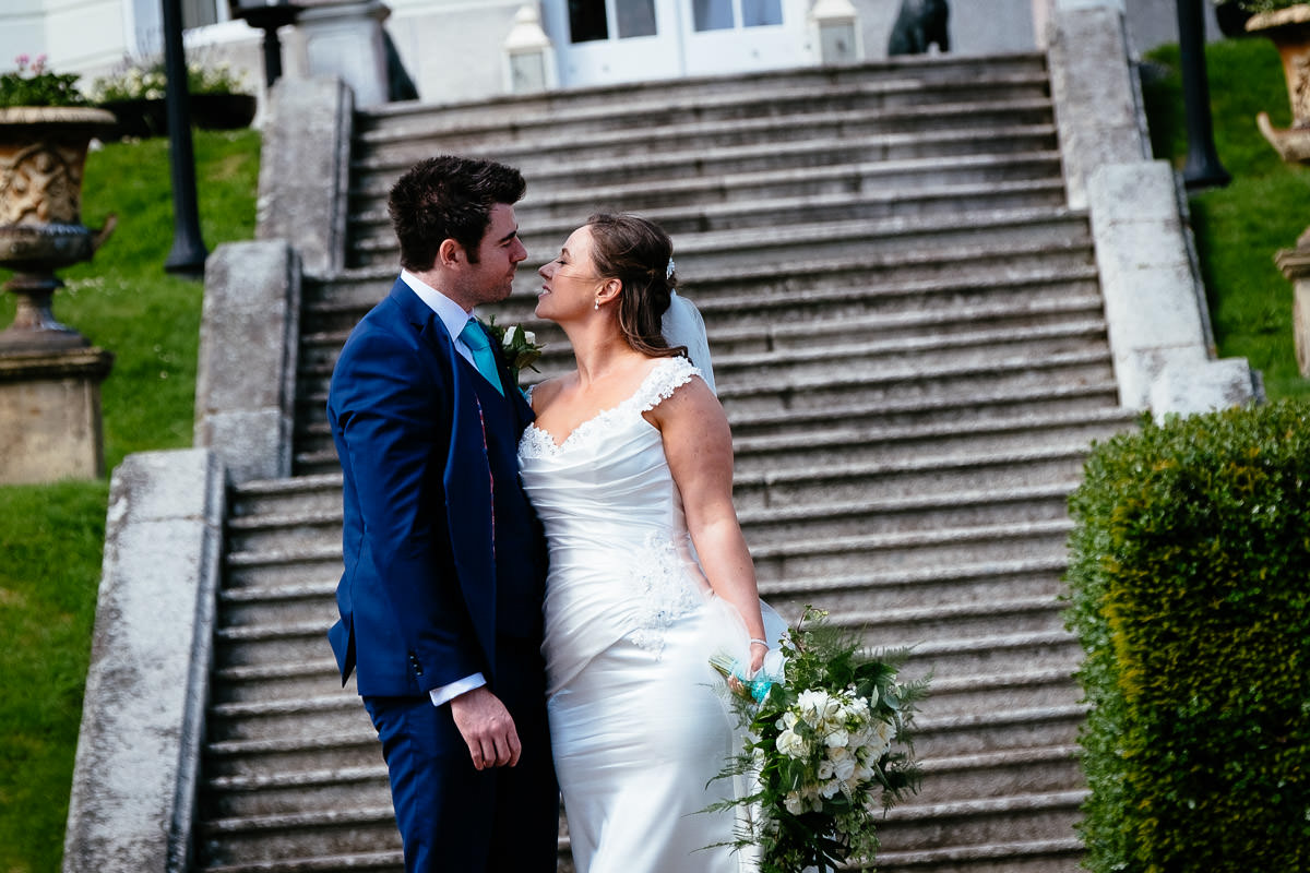 bride and groom kissing at a k club wedding