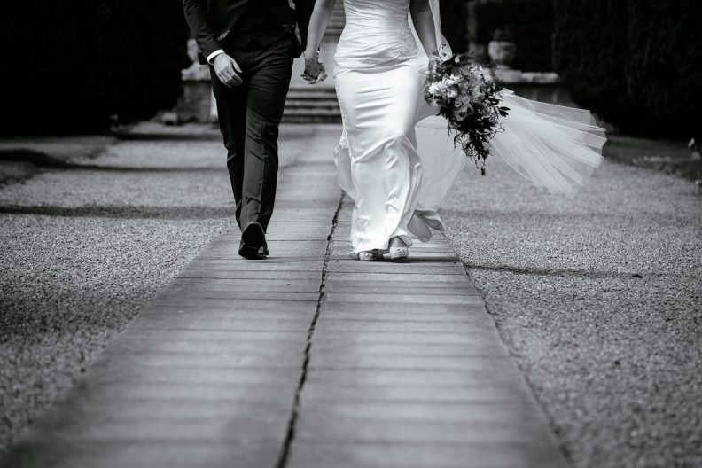 bride and groom walking at a k club wedding