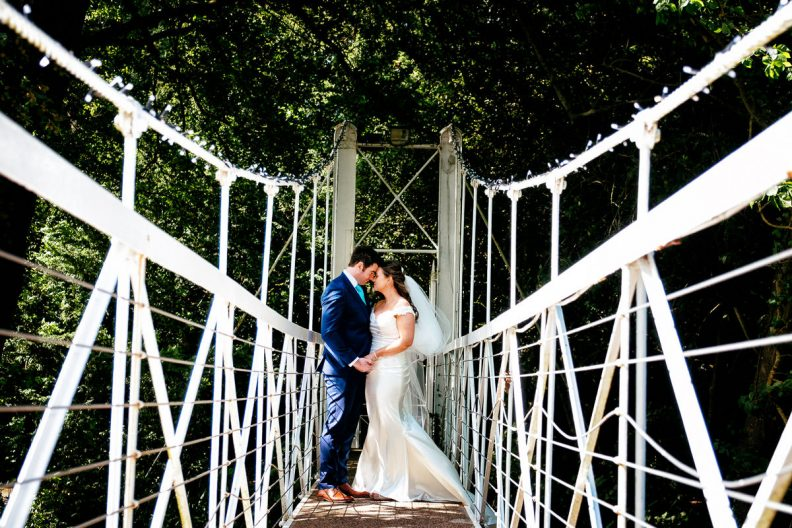 bride and groom on a bridge at a k club wedding