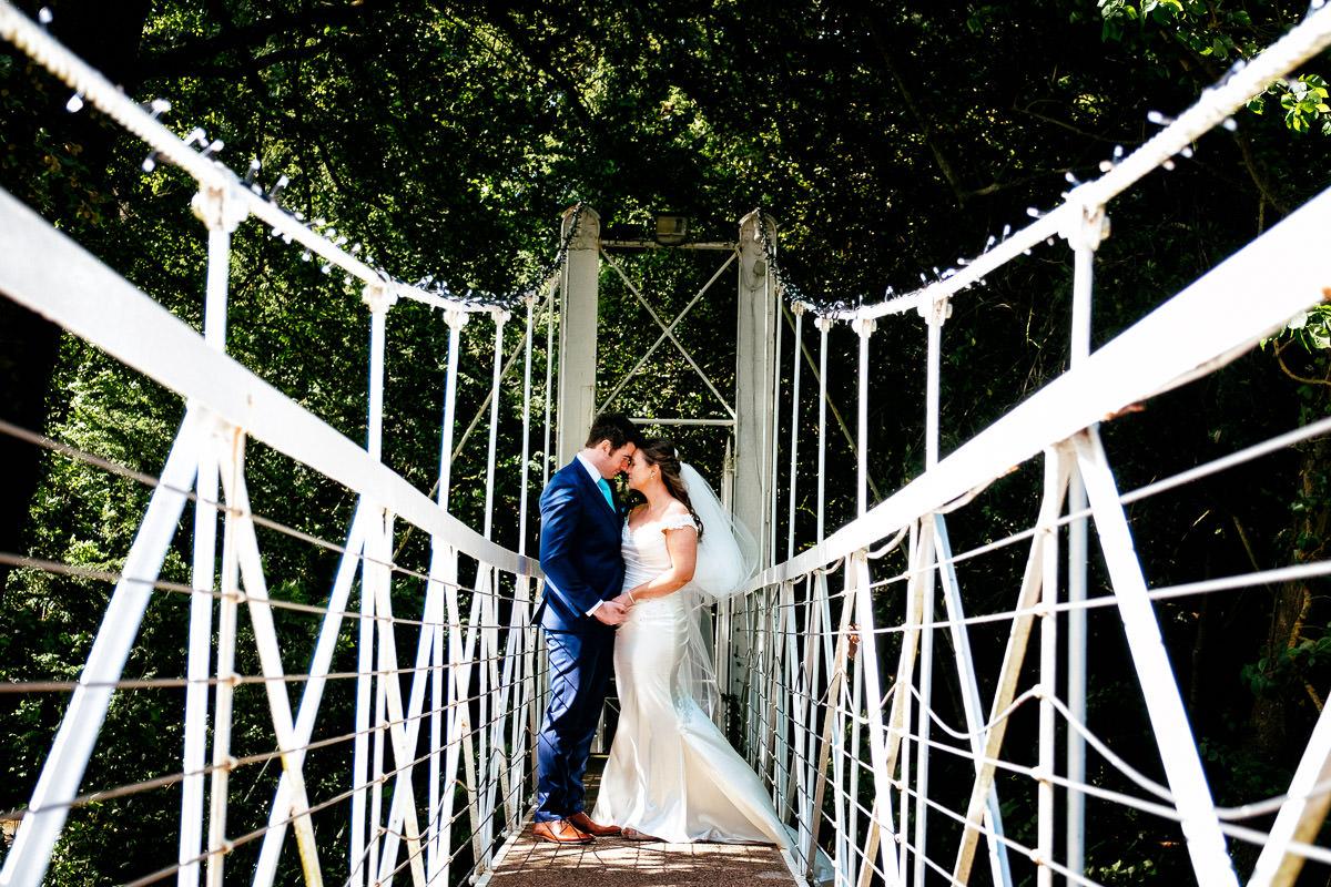 bride and groom on a bridge at a k club wedding