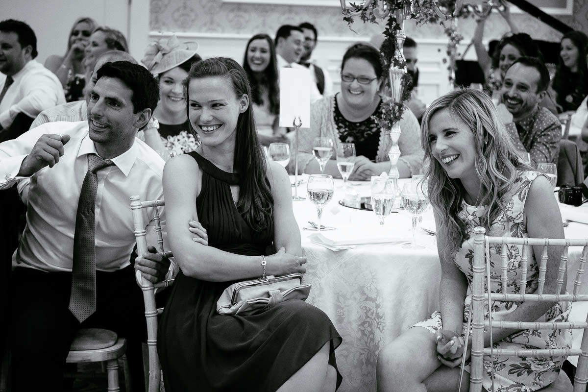 guests laughing during a speech at a k club wedding