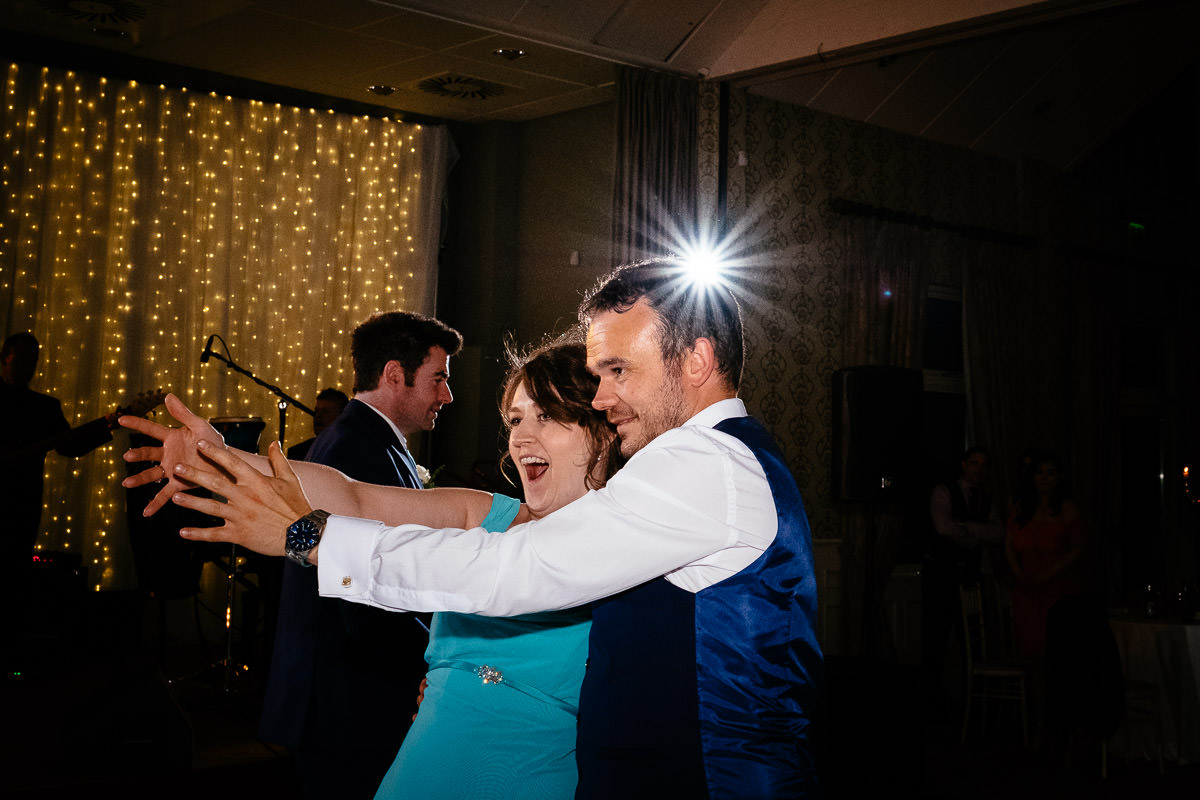 bridal party dancing at a k club wedding