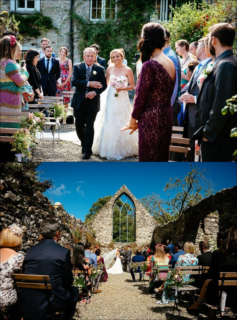 bride walking up the aisle at outdoor wedding ceremony at Huntington Castle Wedding Photography