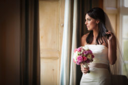 bride at a window in luttrellstown castle