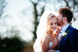 bride and groom embracing at their ballymagarvey village wedding