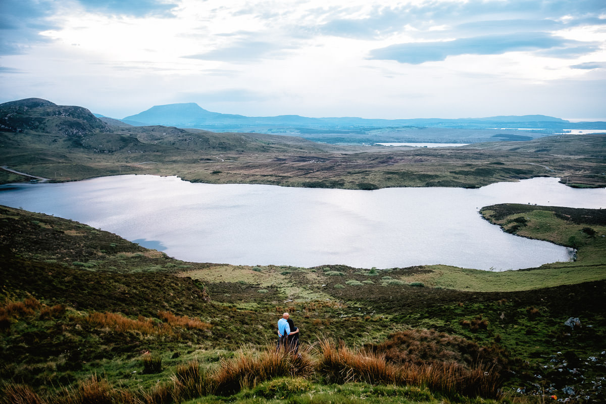 engaged couple walking on mountainside in donegal
