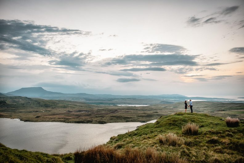 engaged couple standing on mountainside in donegal