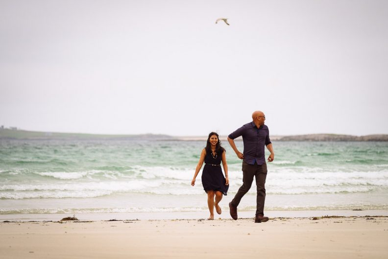engaged couple on a beach in donegal