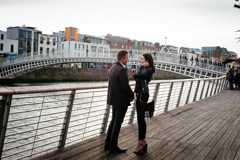 guy about to propose by the river liffey boardwalk in dublin