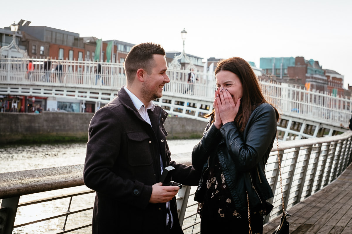 guy who just proposed to his girlfriend by the river liffey boardwalk in dublin