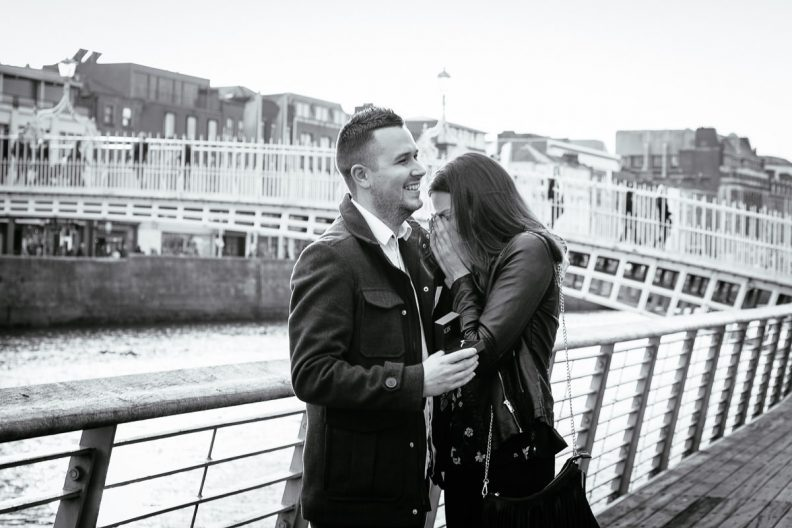 couple proposing by the river liffey boardwalk in dublin