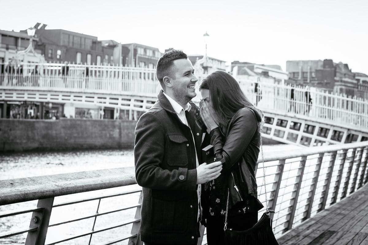 couple proposing by the river liffey boardwalk in dublin