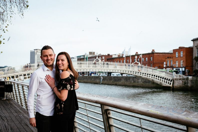 newly engaged couple by the river liffey boardwalk in dublin