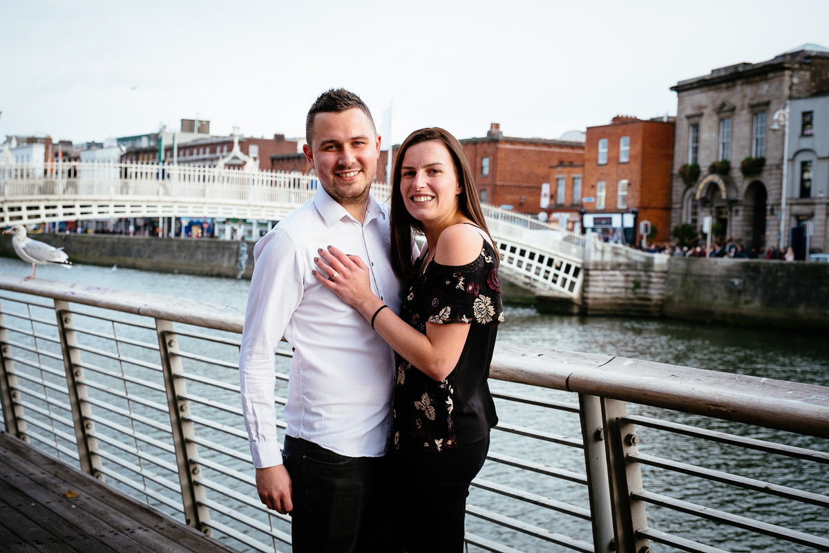 newly engaged couple by the ha'penny bridge in dublin