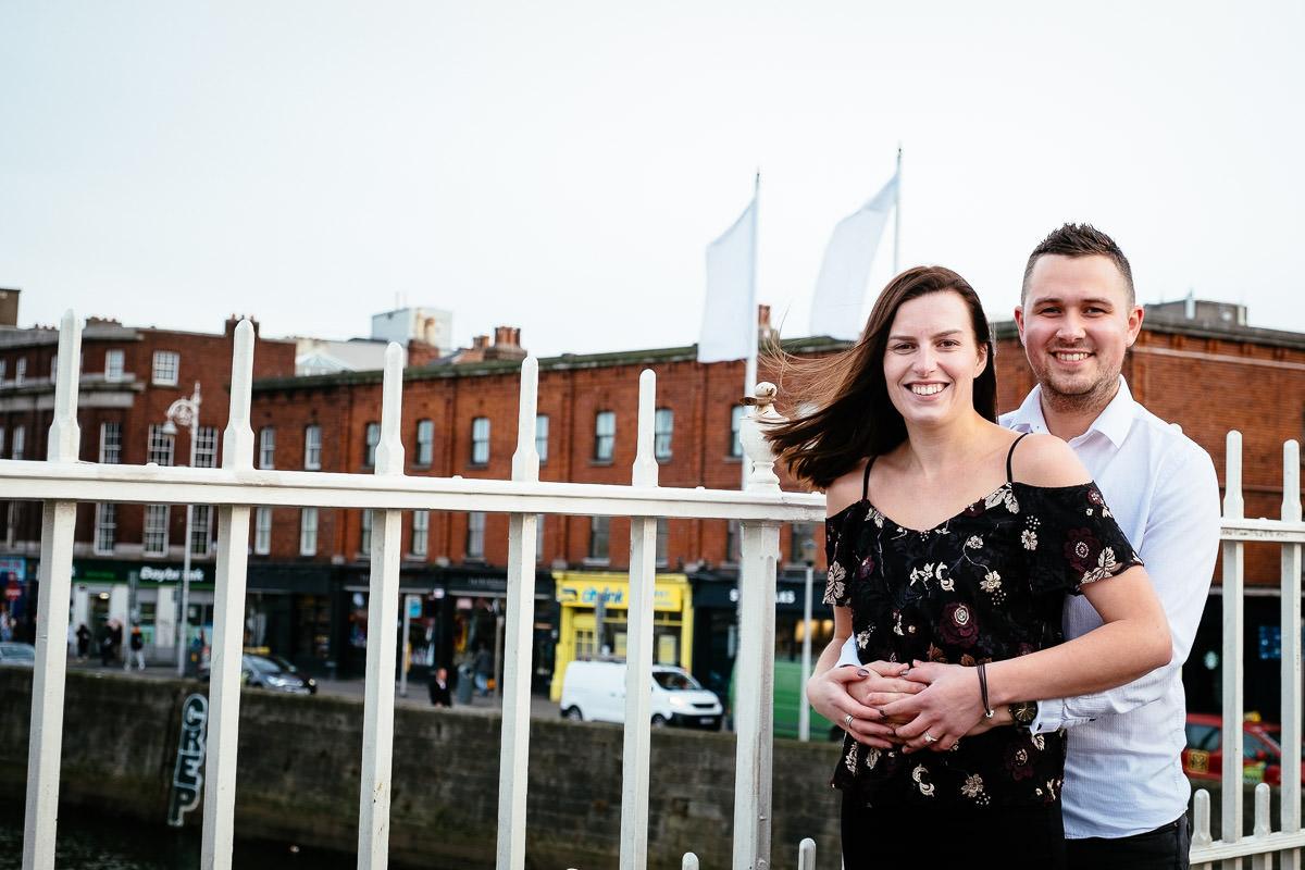 newly engaged couple on the ha'penny bridge in dublin