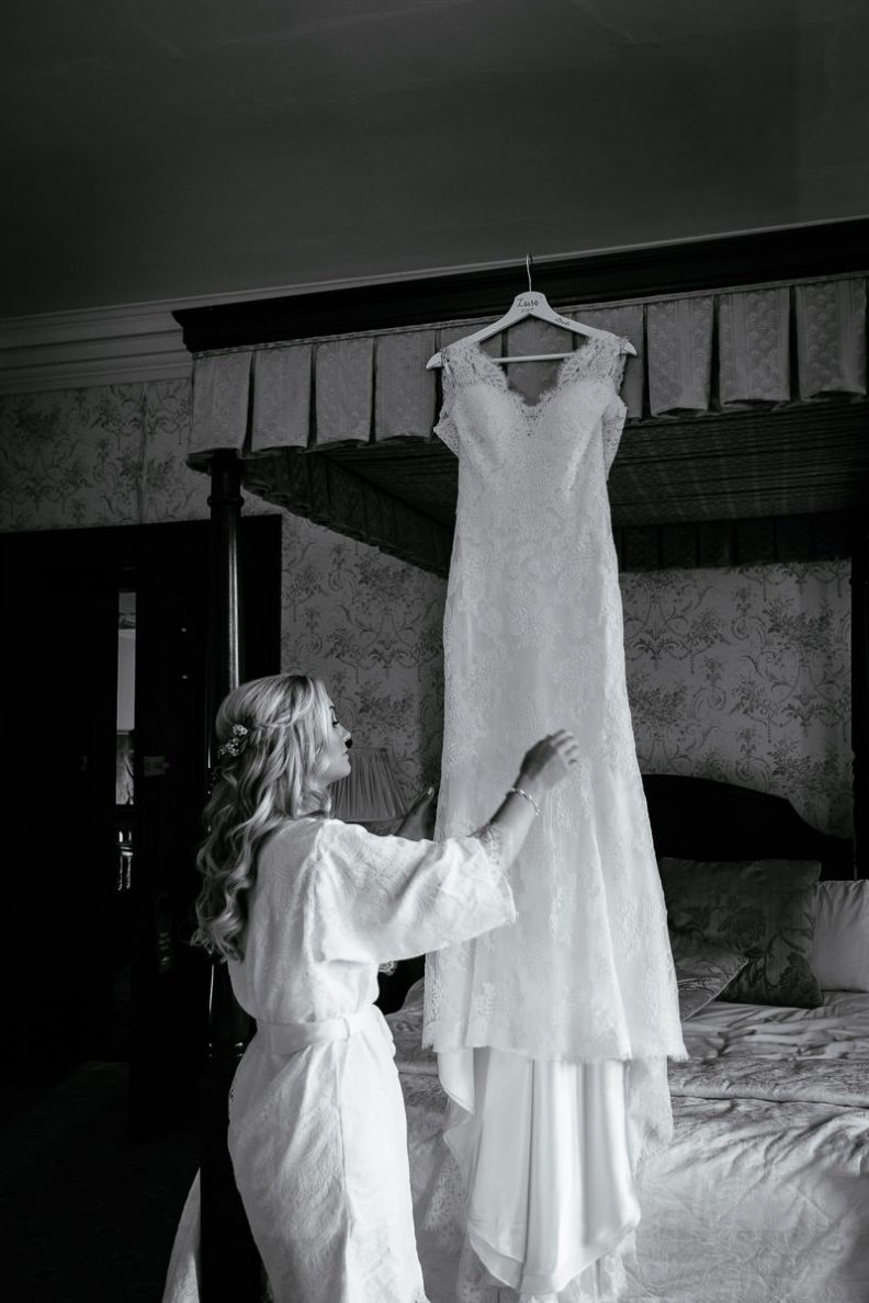bride and her wedding dress hanging at tinakilly country house wedding