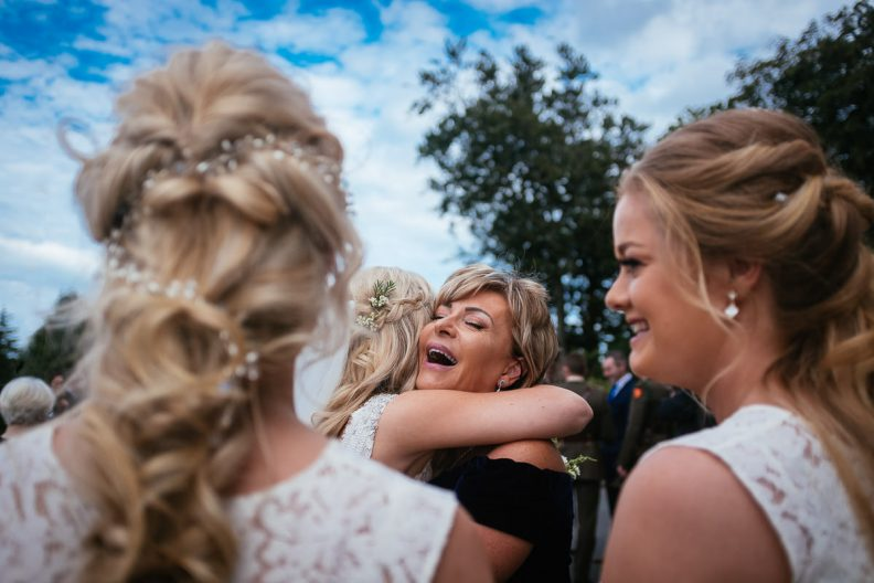 bride hugging mother-in-law at st patricks church wicklow