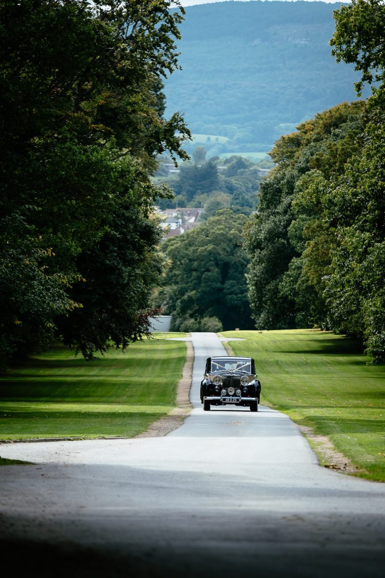 bride and groom arriving in vintage car at tinakilly house
