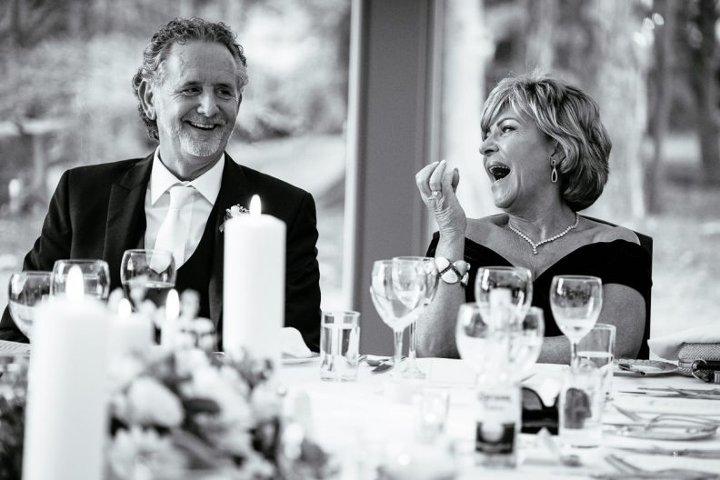 wedding guests laughing at tinakilly country house wedding