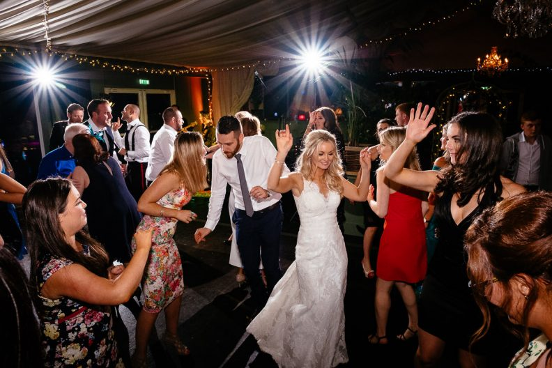 bride and her wedding guests dancing at tinakilly country house wedding