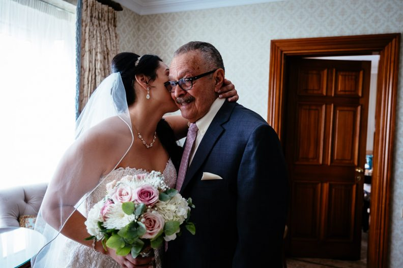 bride kissing her elderly father at glenlo abbey hotel wedding