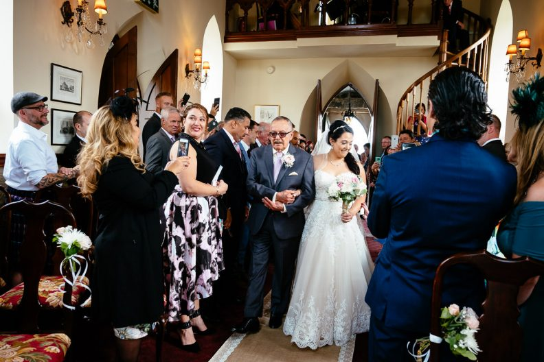 bride walking up aisle at glenlo abbey hotel wedding