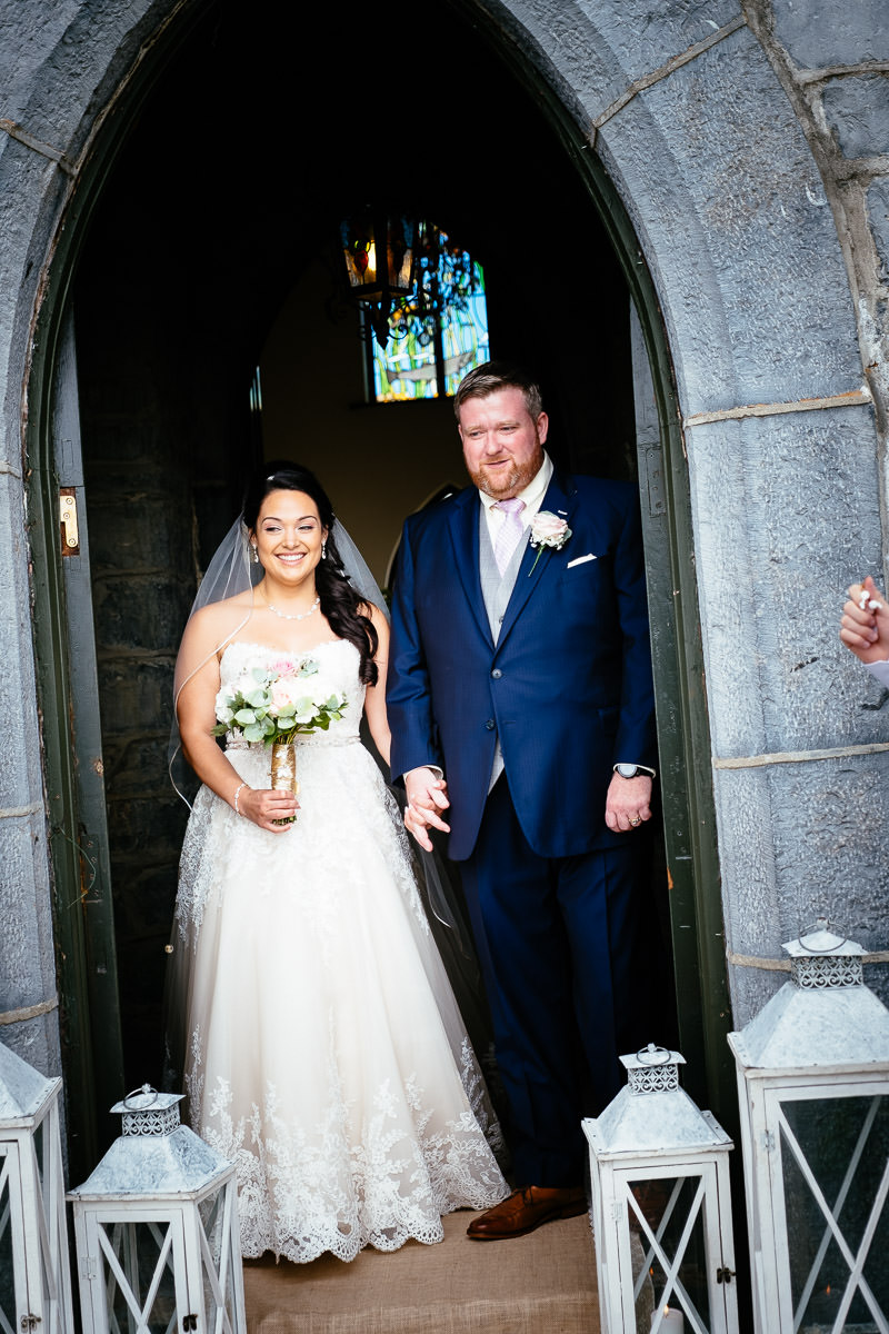 bride and groom embracing at gleno abbey hotel wedding
