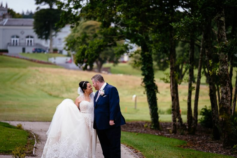 bride and groom kissing at glenlo abbey hotel wedding