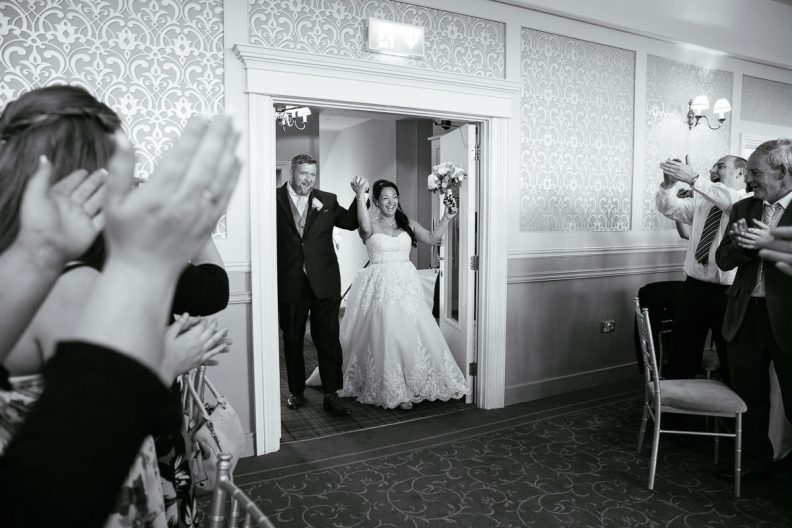 bride and groom entering function room at gleno abbey hotel wedding